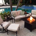 Cast aluminum furniture by the poolside