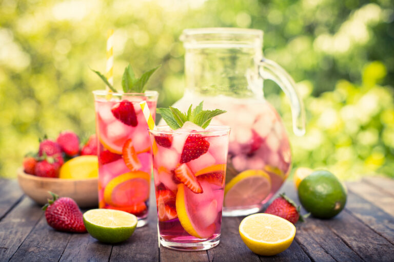 Pink lemonade with lemon, lime and strawberries