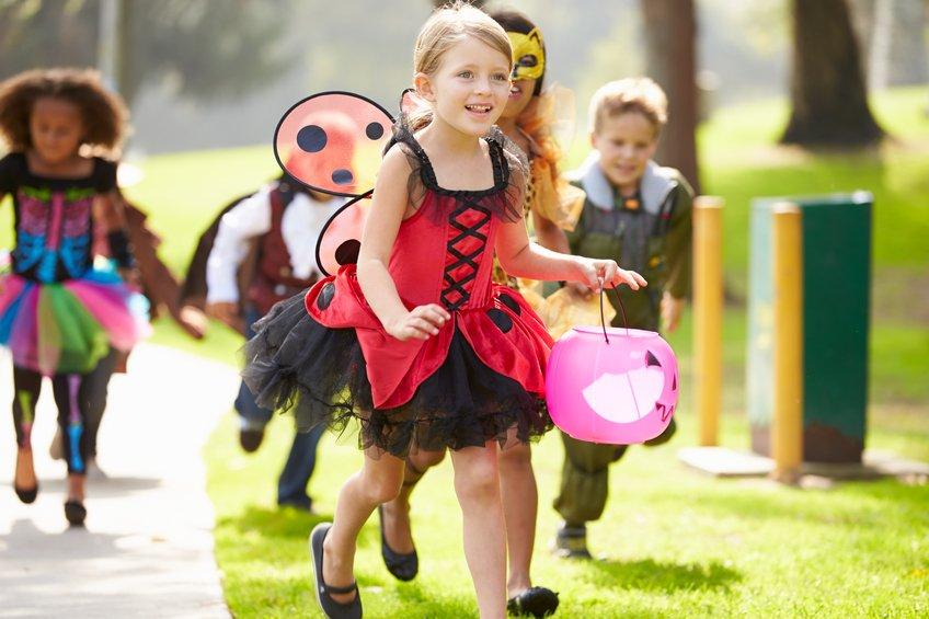 Children In Fancy Costume Dress Going Trick Or Treating Running