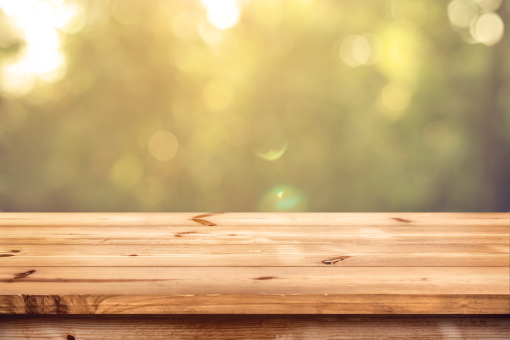 Top of wood table with blurred bokeh nature background - Empty ready for your product display montage.